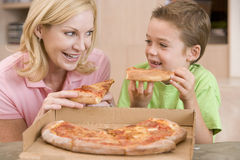 Mother And Son Eating Pizza Together Royalty Free Stock Photos