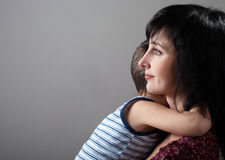 Mother and son embrace Royalty Free Stock Images
