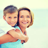 Mother and son in embrace on the beach. Royalty Free Stock Images