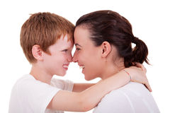 Mother and son embracing cheek to cheek. Isolated on white background, studio shot royalty free stock photos
