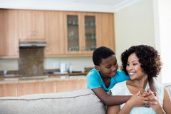 Mother and son embracing each other in living room. At home royalty free stock photos