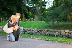 Mother and son embrase in the park Stock Image