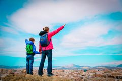 Mother and son enjoy travel together, looking at panoramic city view. Family vacation royalty free stock images