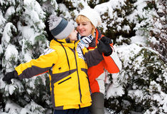 Mother and son enjoying beautiful winter day Stock Images
