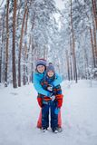 Mother and son enjoying beautiful winter day Royalty Free Stock Image