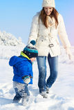 Mother and son enjoying beautiful winter day outdoors, lovely winter time Stock Photos