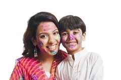 Mother and son enjoying holi Royalty Free Stock Images