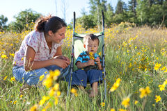 Mother and son enjoying late summer afternoon. In nature. Shallow DOF, focus point is on boy's face Royalty Free Stock Photo