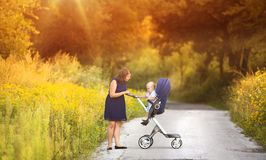 Mother and son enjoying life together outside Stock Photos