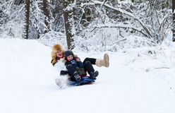 Mother and son enjoying a sleigh ride on a winter day Royalty Free Stock Photos