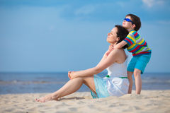 Mother and son enjoying time at tropical beach Royalty Free Stock Photography
