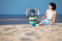 Mother and son enjoying time at tropical beach Stock Photos