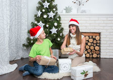 Mother and son are exchanged Christmas gifts Royalty Free Stock Images