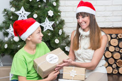 Mother and son are exchanged Christmas gifts Stock Photo