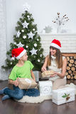 Mother and son are exchanged Christmas gifts Stock Images