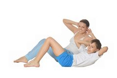 Mother and son exercising Stock Image