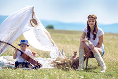 Mother and son in field Royalty Free Stock Images