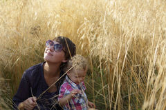 Mother and son in field of grass Stock Images