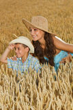 Mother and son in a field of wheat Royalty Free Stock Photo