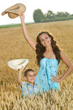 Mother and son in a field of wheat Stock Photos