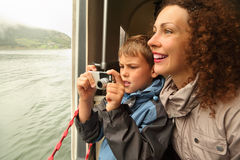 Mother with son float at passengers vessel stock photography
