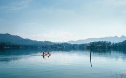 Mother and son floating on kayak together on Cheow Lan lake in Thailand stock photography