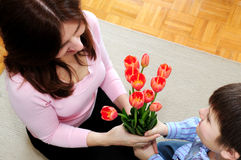Mother and son with flowers Stock Images