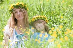 Mother and son with flwer wreaths Stock Photo