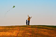 Mother and son fly a kite Royalty Free Stock Images