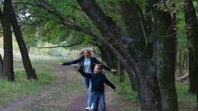Mother and son fooling around stock footage