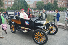 Mother and son in Ford Model-T from Michigan. Model-T racer arrives at finish line of the Ocean to Ocean 1909 auto race re-enactment Seattle 2009 Royalty Free Stock Photos
