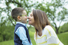 Mother and son in forest on a meadow Royalty Free Stock Images