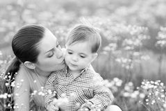 Mother and son on fresh air. Caucasian mother and 1 year old son on fresh air Royalty Free Stock Images