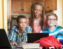 Mother with son and friend doing homework Royalty Free Stock Photography