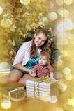 Mother and son  in front of Christmas tree Royalty Free Stock Photo