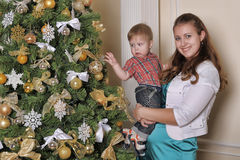 Mother and son  in front of Christmas tree Royalty Free Stock Images
