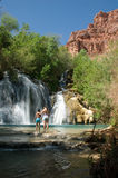 Mother and Son in front of Navajo Falls in Havasu, Arizona. Mother and Daughter standing in front of Navajo Falls on Havasu Creek, Arizona Stock Image