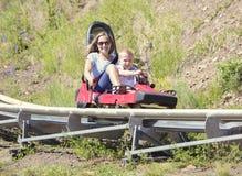Mother and son on a fun roller coaster ride Stock Photos