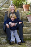 Mother & Son In The Garden Royalty Free Stock Photo