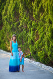 Mother and son in garden Royalty Free Stock Image