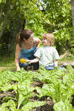 Mother And Son Gardening Stock Image
