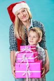 Mother and son with gift boxes Stock Photo