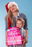 Mother and son with gift boxes Stock Photography