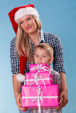 Mother and son with gift boxes Royalty Free Stock Images