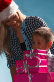 Mother and son with gift boxes Royalty Free Stock Photo