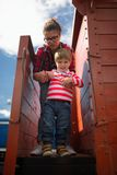 Mother and the son go down from the car of the freight train Stock Images