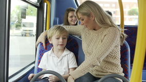 Mother And Son Going To School On Bus Together Royalty Free Stock Photo