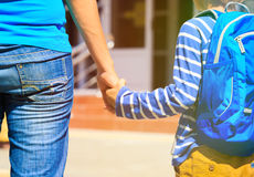 Mother and son going to school. Mother and son holding hands while going to school Royalty Free Stock Photography