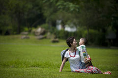 Mother and son in grass Royalty Free Stock Images