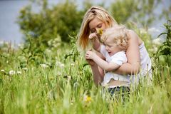 Mother and Son in Grass Field Royalty Free Stock Photography